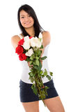 Beautiful girl holding flowers Stock Photo