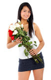 Beautiful girl holding flowers Royalty Free Stock Photography