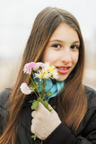 Beautiful girl holding flowers Stock Image
