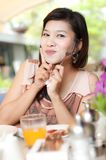 Beautiful girl holding fork and enjoy her food Royalty Free Stock Images