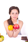 Beautiful girl holding fruit in hand Stock Photography
