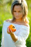 Beautiful girl holding fruit outdoor Stock Photography