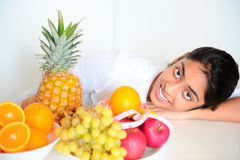 Beautiful girl holding fruits and a measure tape Royalty Free Stock Photos
