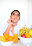Beautiful girl holding fruits and a measure tape Stock Images