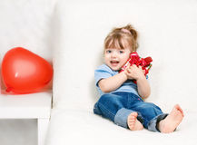 Beautiful girl holding a gift Stock Photography