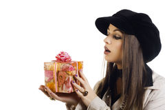 Beautiful girl holding a gift Stock Image