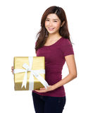 Beautiful girl holding a gift box Royalty Free Stock Photos