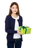 Beautiful girl holding a gift box isolated on white background Royalty Free Stock Images