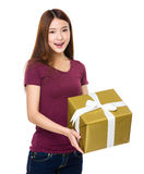 Beautiful girl holding a gift box Royalty Free Stock Photography