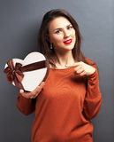 Beautiful girl holding gift in heart form Royalty Free Stock Images