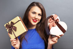 Beautiful girl holding gifts Royalty Free Stock Image