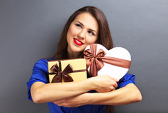 Beautiful girl holding gifts Stock Image