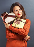 Beautiful girl holding gifts Stock Photography