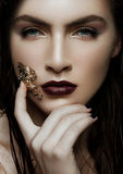 Beautiful girl holding golden diamond frog jewelry Stock Images