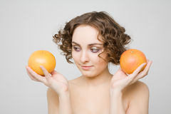 Beautiful girl holding grapefruits Stock Photo