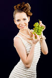 Beautiful girl holding grapes Stock Photos