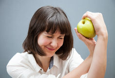 Beautiful girl holding a green apple Stock Photography