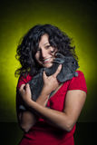 Beautiful girl holding a grey rabbit Stock Image