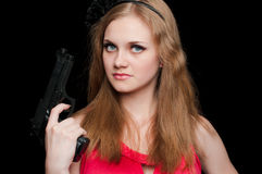 Beautiful girl holding a gun Royalty Free Stock Photo