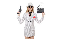 Beautiful girl holding hand gun and clapperboard Royalty Free Stock Image