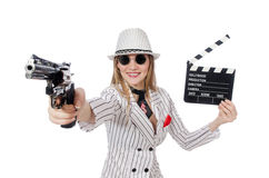 Beautiful girl holding hand gun and clapperboard Royalty Free Stock Images