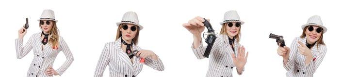 The beautiful girl holding hand gun isolated on white Stock Photo
