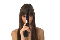 Beautiful girl holding a handgun Stock Images