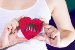 Beautiful girl holding a heart in hands Royalty Free Stock Photography