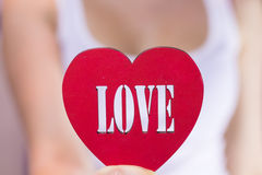 Beautiful girl holding a heart in hands Royalty Free Stock Images