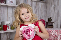 Beautiful girl holding a heart-shaped box Stock Photo