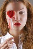 Beautiful girl holding heart-shaped symbol Royalty Free Stock Image