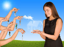 Beautiful girl holding house from the air. Many Royalty Free Stock Photo