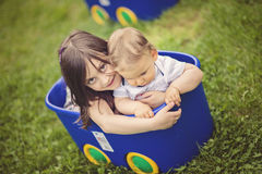 Beautiful girl holding and hugging her  brother Royalty Free Stock Photo