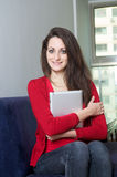 Beautiful girl holding an ipad Royalty Free Stock Photo
