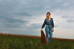 Beautiful girl holding a jacket Royalty Free Stock Photography