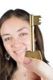 Beautiful girl holding key of success Royalty Free Stock Photos