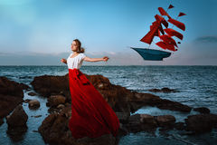 Beautiful girl holding a kite Stock Images