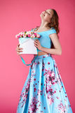 Beautiful girl holding large bouquet of paper flowers in box Stock Photos