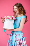 Beautiful girl holding large bouquet of paper flowers in box Royalty Free Stock Image