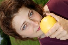 A beautiful girl is holding a lemon Royalty Free Stock Photo