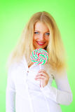 Beautiful girl holding lollipop Stock Photo