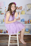 Candy shop. A beautiful girl holding lollipops in a candy shop Stock Photos