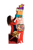Beautiful girl holding a lot of boxes with gifts Royalty Free Stock Photos
