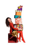 Beautiful girl holding a lot of boxes with gifts Stock Image