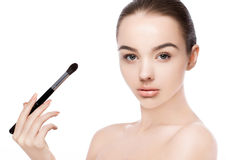 Beautiful girl holding makeup brush for foundation Royalty Free Stock Photography