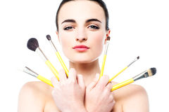 Beautiful girl holding makeup brushes set Royalty Free Stock Photography