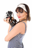 Beautiful girl holding old camera Stock Photography