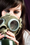 Beautiful girl is holding an old gasmask Royalty Free Stock Images