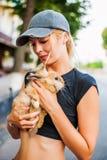 Beautiful girl with pet rabbit Stock Images