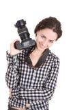 Beautiful girl holding a photo camera Stock Photography